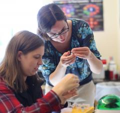 Rachel Johnson in her lab with Meagan Rollins '17